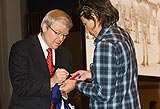 Prime Minister Kevin Rudd signing Sconey's flag