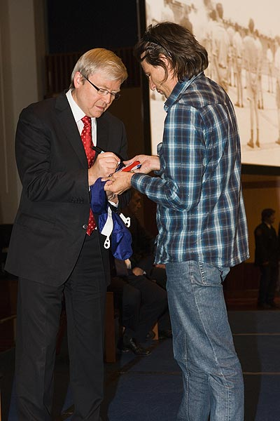 Kevin Rudd signing Sconey's flag of the Forgotten Australians South Australia Inc.