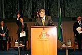 Harry Jenkins at the podium in the Great Hall of Parliament House, with Jenny Macklin, Kevin Rudd and Malcolm Turnbull in the background.