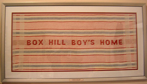 Towel printed with the words 'BOX HILL BOY'S HOME'