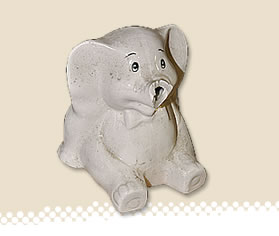 ceramic elephant with broken trunk